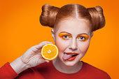 istock Young beautiful fashion model with orange. studio shot. 509345802