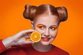 istock Young beautiful fashion model with orange. studio shot. 509345900