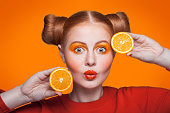 istock Young beautiful fashion model with orange. studio shot. 509345982