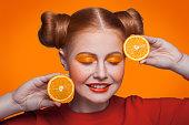 istock Young beautiful fashion model with orange. studio shot. 509346044