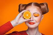 istock Young beautiful fashion model with orange. studio shot. 509346136