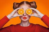 istock Young beautiful fashion model with orange. studio shot. 509346224