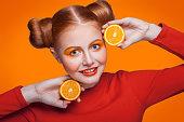 istock Young beautiful fashion model with orange. studio shot. 509346390