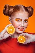 istock Young beautiful fashion model with orange. studio shot. 509346446