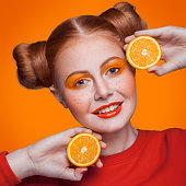 istock Young beautiful fashion model with orange. studio shot. 509346480