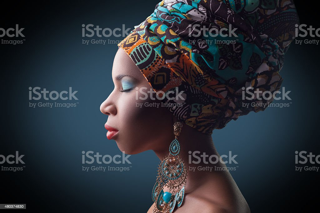 young beautiful fashion model with traditional african style stock photo