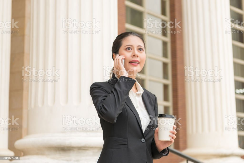 young beautiful female business lawyer calling stock photo