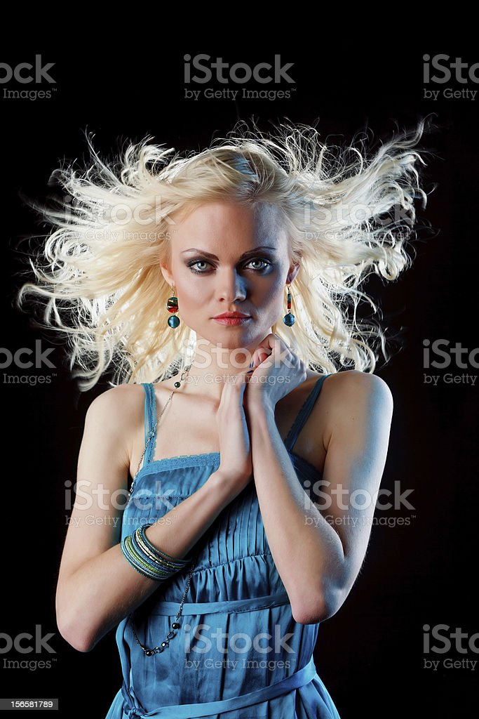 Young beautiful female in the wind royalty-free stock photo