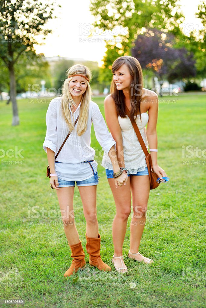 Young beautiful friends together in the city park royalty-free stock photo