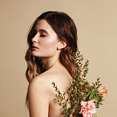 Young beautiful girl and flowers