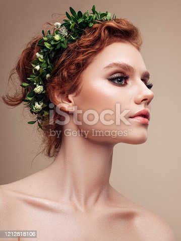 Young beautiful girl and leaves wreath