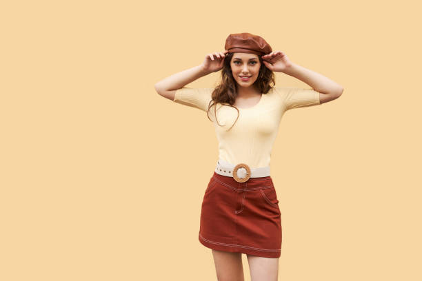 Young beautiful girl dressed in retro vintage style in the old european city stock photo