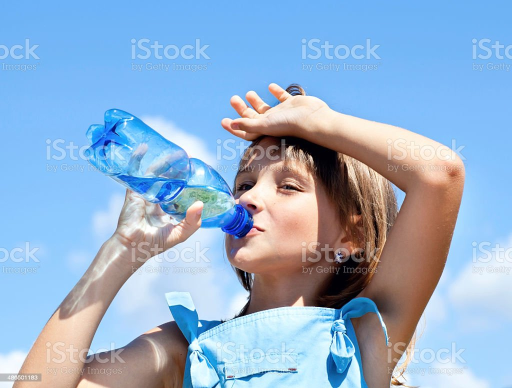 Young beautiful girl drinking water stock photo