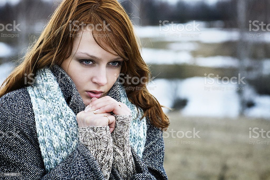Young beautiful girl froze and warmed the hands of breath royalty-free stock photo