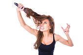 Young beautiful girl having problems while hair. Isolated studio shot.