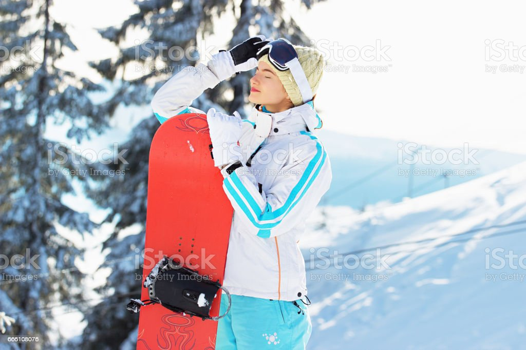 132160aaa2b Young Beautiful Girl In White Jacket Blue Ski Pants And Googles On ...