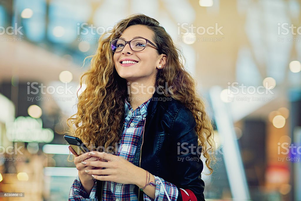 Young beautiful girl is shopping in the Mall stock photo