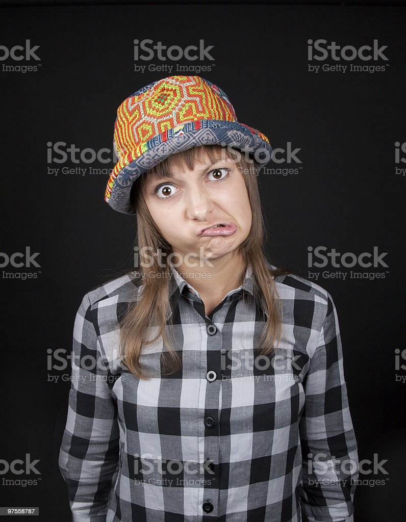 Young beautiful girl makes faces royalty-free stock photo