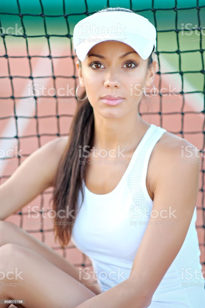 Young, beautiful girl on the tennis court royalty-free stock photo
