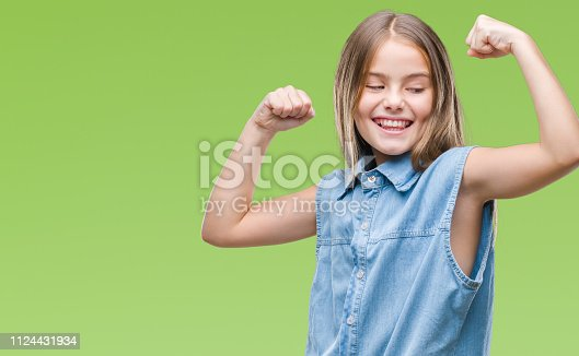 Young beautiful girl over isolated background showing arms muscles smiling proud. Fitness concept.