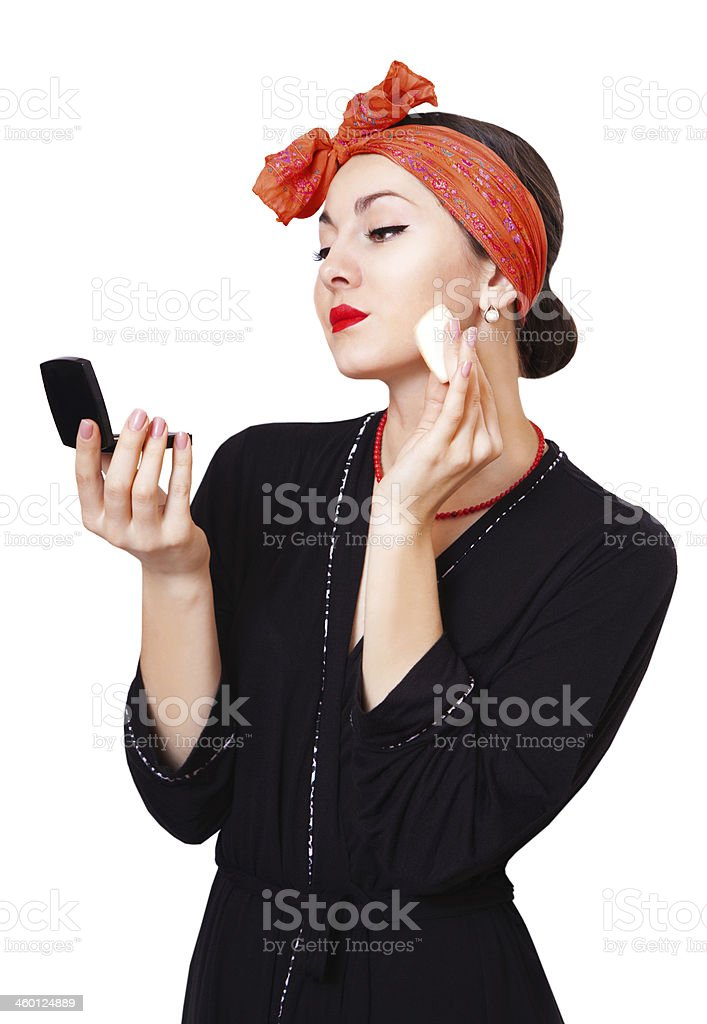 Young beautiful girl powders her face, retro styling royalty-free stock photo