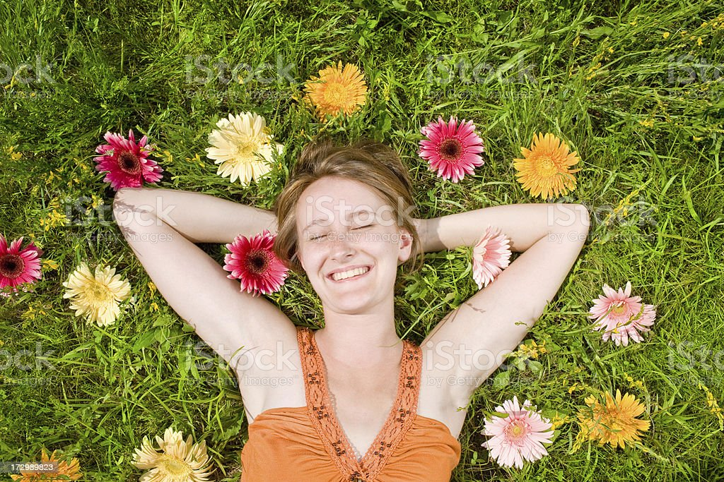 young beautiful girl relax at field in sunny day royalty-free stock photo