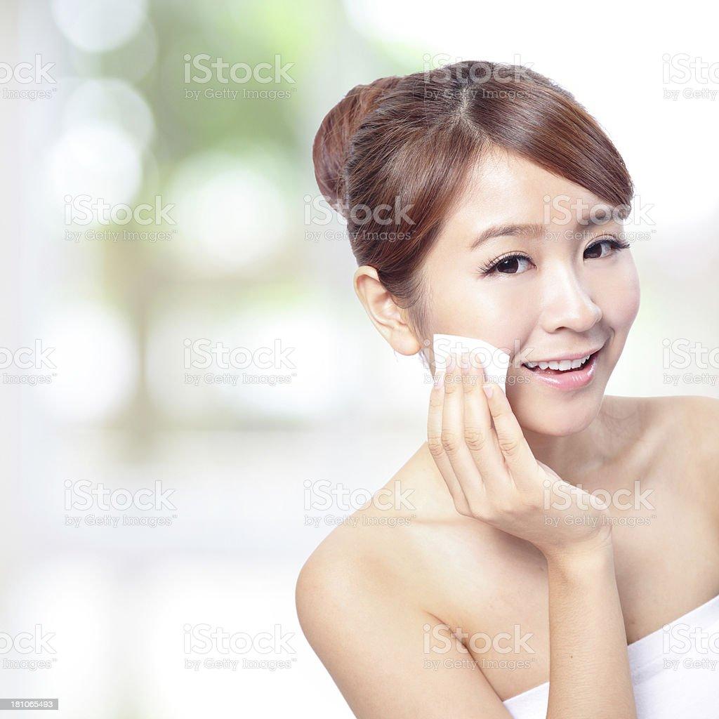 Young Beautiful Girl remove makeup royalty-free stock photo