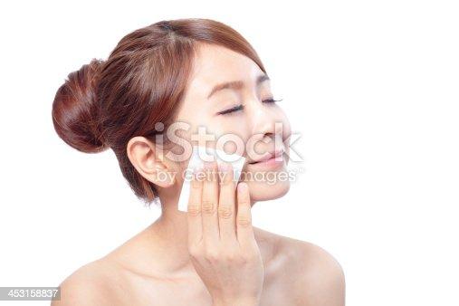istock Young Beautiful Girl remove makeup 453158837