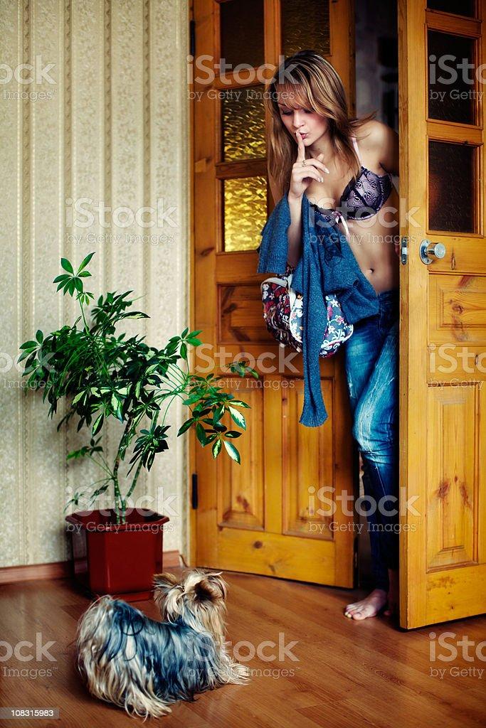 Young beautiful girl secretly returned home stock photo