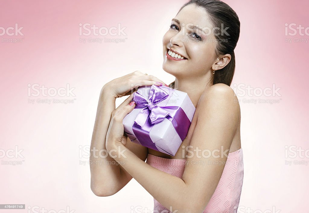 Young beautiful girl with a gift box royalty-free stock photo