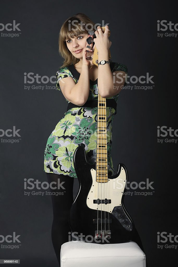 Young beautiful girl with a guitar royalty-free stock photo