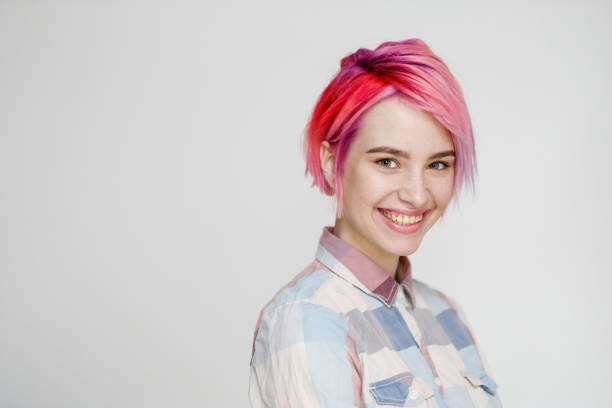 young beautiful girl with a short hair cut pixie bob. color hair coloring, red pink color. shirt in a cellar, casual style. - capelli corti foto e immagini stock