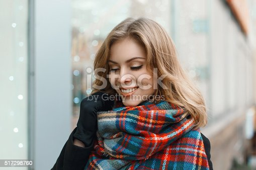 1051172208 istock photo Young beautiful girl with a smile in vintage scarf 517298760