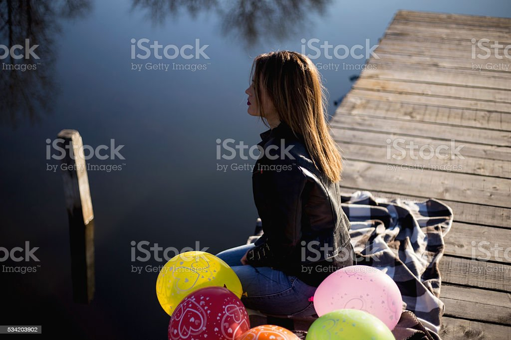 Young beautiful girl with colorful ballons stock photo