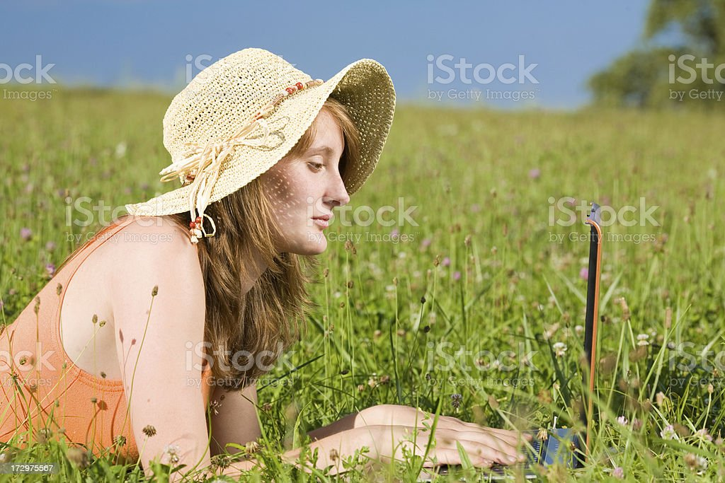 young beautiful girl work or study with laptop outdoor royalty-free stock photo