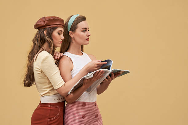 Young beautiful girls dressed in retro vintage style enjoying the old european city lifestyle stock photo