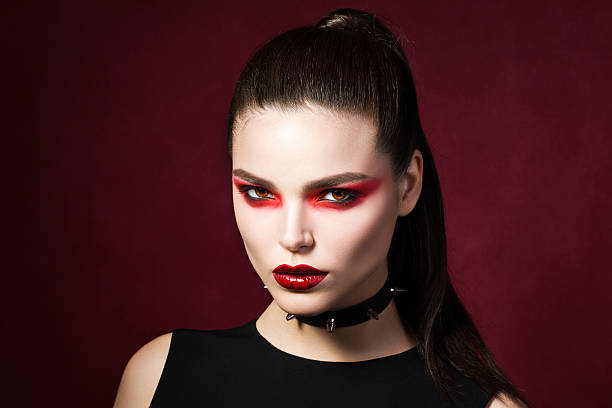 young beautiful gothic woman with white skin and red lips - gothic fashion stock photos and pictures
