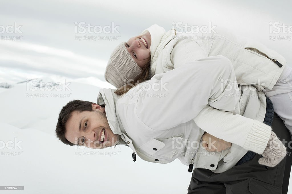young beautiful happy couple man girl play winter  snow outdoor royalty-free stock photo