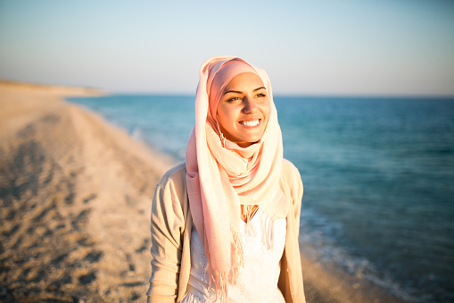 istock Young beautiful happy muslim woman on the beach 494992422