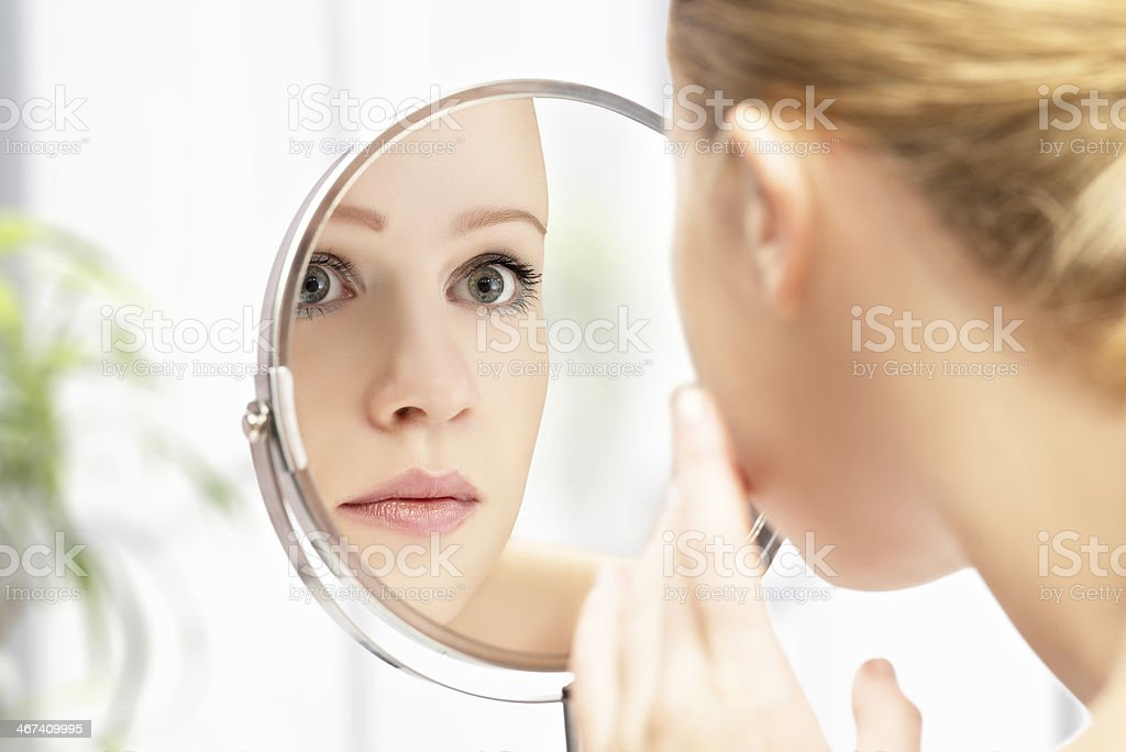 young beautiful healthy woman and reflection in the mirror face of young beautiful healthy woman and reflection in the mirror Mirror - Object Stock Photo