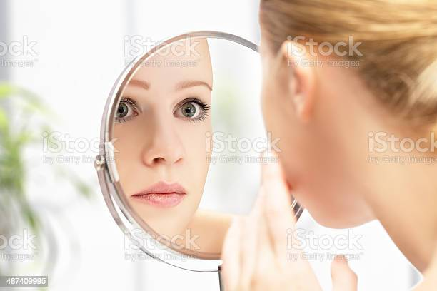 Young Beautiful Healthy Woman And Reflection In The Mirror Stock Photo - Download Image Now