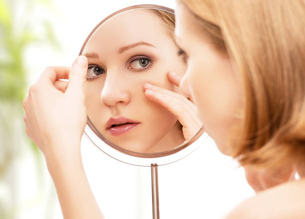 young beautiful healthy woman and reflection in the mirror - color intensity stock pictures, royalty-free photos & images