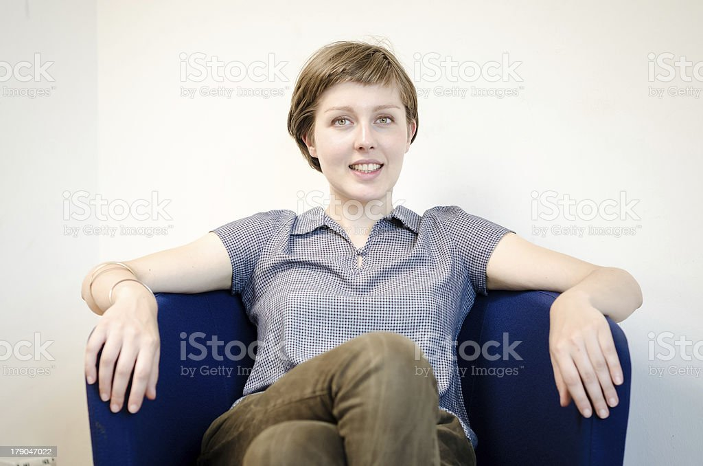 young beautiful hipster woman sitting in the armchair stock photo