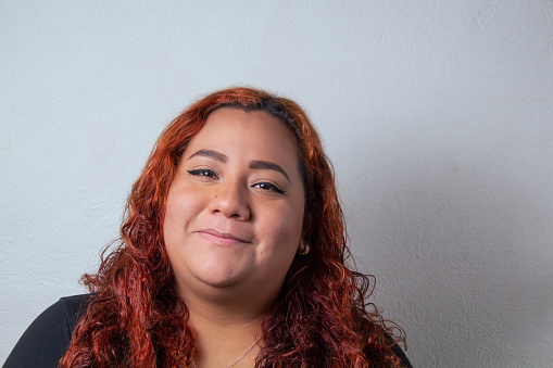 Young beautiful Mexican woman. Happy Plus Size Model