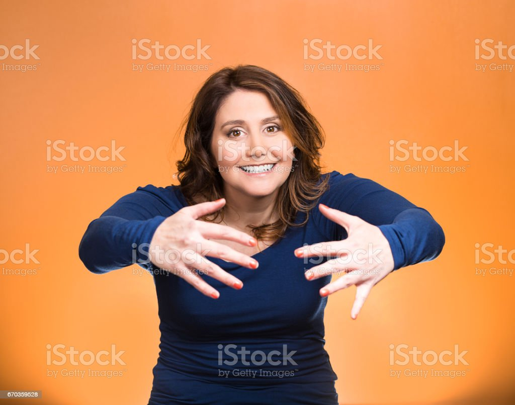 young beautiful, middle aged smiling, happy, kind woman with raised up palms arms at you offering hug stock photo