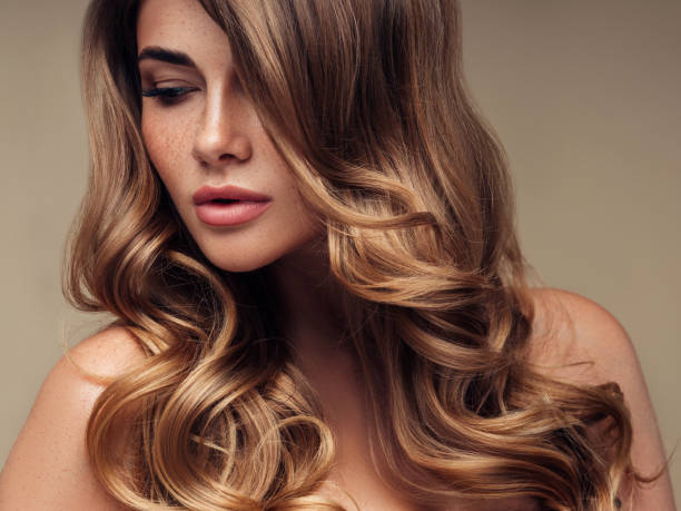 young beautiful model with long wavy well groomed hair - beauty foto e immagini stock