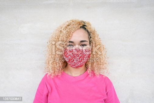 Young beautiful multiracial woman wearing protective face mask - Portrait - Concept of health care and follow safety measures