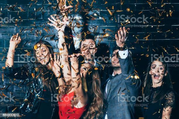 Young beautiful people dancing in confetti picture id884830810?b=1&k=6&m=884830810&s=612x612&h=p49si0ndndxk9dyckinumuu91jobwavrc7xujquy5eg=