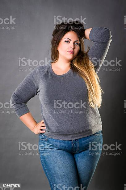 Model jeans image Young Beautiful Plus Size Model In Blue Jeans Xxl Woman Stock Photo Download Image Now Istock