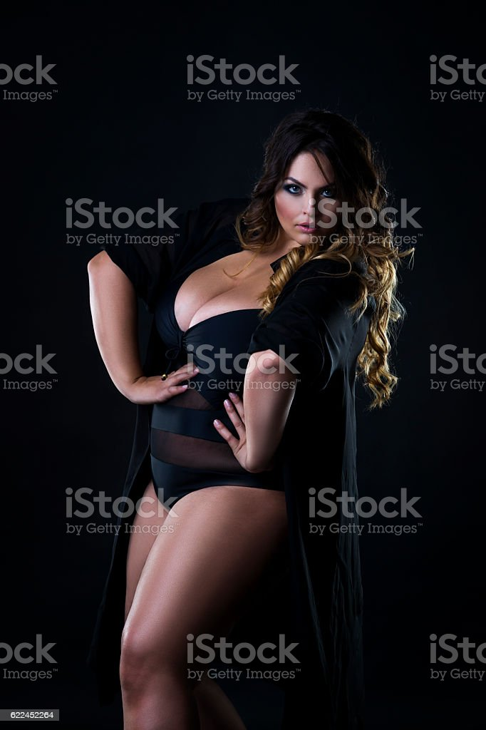 Young beautiful plus size model in underwear, xxl woman stock photo